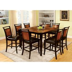 Make dinnertime a bit more elegant with this matching nine-piece black upholstered dining set. The eight wood chairs have tapered legs, keeping them sturdy, while the plush seats feature leatherette lining, ensuring everyone's comfort during mealtime.