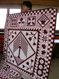Was browsing for a sampler quilt that would work in the pink stash I have to do a breast cancer quilt.  That tree of life in the center is perfect, and I love the applique accents.