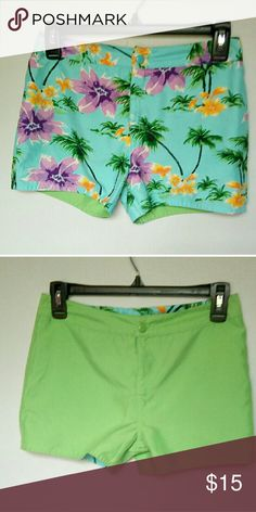 "Like New reversible Hawaiian print/green shorts Reversible shorts, one side is a tropical pattern, and the other is a light green. Very soft material. 10/10 condition It's like buying 2 pairs of shorts for the price of 1! 28"" around the waist Bottoms Shorts"