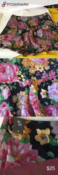 Abercrombie Floral with gold skirt NWT 8 This is a size 8 skirt by Abercrombie and Fitch that is new with tags never been worn.  It had Floral print with navy and shiny gold on it.  I added a close up of the print. Abercrombie & Fitch Skirts