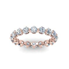 Floating Diamond Eternity Bands For Women with Diamonds in 14K Rose Gold exclusively styled by Fascinating Diamonds