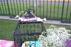 Card's sign in a birdcage for purple themed wedding. Colors also used are wine, eggplant, burlap, and lace themed wedding.