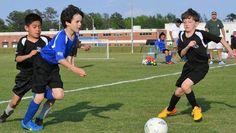 soccer game passing ball team