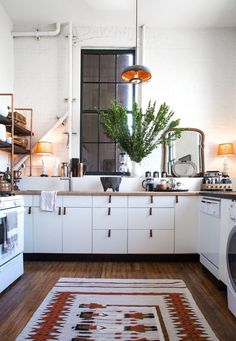 Scandinavian Kitchen - I love the industrial details, the lamps and the mirror