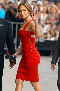 Jennifer Lopez showcased her world-famous assets in a tight red dress heading into the L.A. studios of Jimmy Kimmel Live for a March 10 appearance.