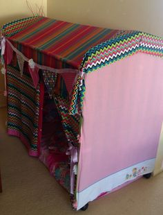 Little girls cubby house made from a old baby's cot, a table cloth, cot sheets & fabric I had in my stash.