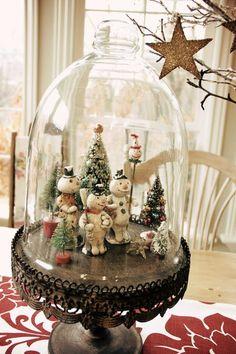 Snowmen gathering under the cloche