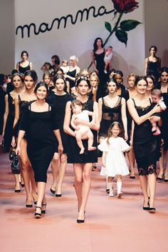 Runaway : Dolce & Gabbana Fall 2015 | JE T'AIME MAMAN perfectly sums up Dolce & Gabbana's collection, for it was a beautiful ode to the mother, with models walking down the runway with their laughing children in their arms—perfect for the upcoming Mother's Day celebrations.