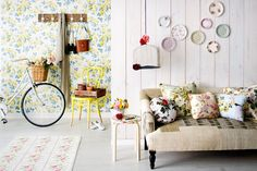 Love the yellow and blue floral wallpaper, covered budgie cage and crockery on the wall. #crockery #furniture #hallways
