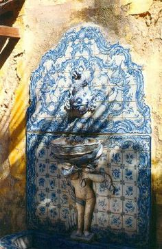 Portuguese Tile Fountain Handmade tiles can be colour coordinated and customized re. shape, texture, pattern, etc. by ceramic design studios Portuguese Culture, Portuguese Tiles, Portuguese Food, Spanish Tile, Blue And White China, Blue Tiles, Moroccan Tiles, Handmade Tiles, Moorish