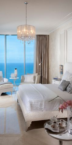 Gorgeous Bedroom with an amazing view of the ocean! by DKOR Interiors