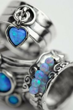 Beautiful blue stone (labradorite and/or opal, it looks like) silver rings.