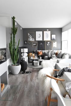 Switch out the grey for soft blush and the whit wash oak floors for a warmer hued wood