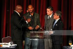 Former N.Y. Giant George Martin, former New York Giants wide receiver Amani Toomer, actor Jim Caviezel and author Eric Metaxas during the Athletes In Action 2014 Super Bowl Breakfast, featuring the Presentation of the Bart Starr Award, at the Marriott Marquis New York in New York City.