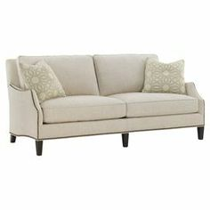 "Showcasing light beige upholstery and nailhead trim, this understated sofa offers a neutral anchor for colorful pillows and decor.  Product: SofaConstruction Material: Wood, metal, fabric and feather down fillColor: Light beigeFeatures:  Recessed armsNailhead trimAccent pillows includedHandmadeDimensions: 35.5"" H x 79"" W x 39.5"" D"