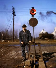 February 1943. Daniel Senise throwing a switch in an Indiana Harbor Belt Line railyard