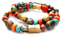 "Gemstone Beaded Necklaces - This is a bead necklace with stones of tiger's eye, carnelian, turquoise, spiny oyster, smoky quartz and more. It is 17"" long, .38"" wide, has an ornate sterling silver magn"