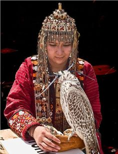 Turkmen woman with pet hunting Falcon.