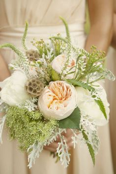 Soft peach garden roses, lysimaichia, scabiosa pods, queens anne lace bouquet