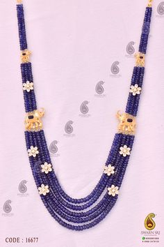 Blue Sapphire Beads Necklace, TRIPLE-STRAND SAPPHIRE BEAD AND SWAROVSKI NECKLACE. Composed of 380 sapphire beads measuring approximately., having approx weight 364.00 cts, arranged in five, three and two-row segments, separates into five segments, connected by four elephants pierced pendants and seven pieces of flowers set with round and oval Swarovski stones weighing approximately 5.80 carats, mounted in 22 karat gold, total length approximately 18 inches, Swarnsri Gold & Diamonds…
