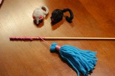 DIY cat toy you can entertain the cats while you sit on the couch