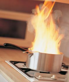Kitchen Safety Tips:  When a Fire Starts  Grease fires should be handled carefully. Baking soda works, but it takes quite a bit of powder, which isn't always close at hand. The safest and most effective way to extinguish a grease fire is to smother it. Use a non-glass lid on a flaming pot or pan to suffocate the fire, and always be ready to dial 911.