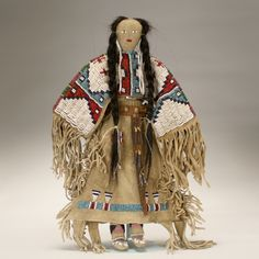 Native American Collections  There was a large session featuring Native American items, including costumes, objects and accessories. Several lots saw serious bidding; most sold within or above estimate.  One very desirable antique Sioux beaded buckskin doll kindled some stiff competition,  ending at its high estimate of $400.