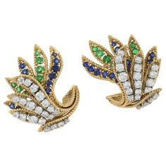 Van Cleef & Arpels Mid-20th Century Jeweled and Gold Ear Clips | From a unique collection of vintage clip-on earrings at http://www.1stdibs.com/jewelry/earrings/clip-on-earrings/