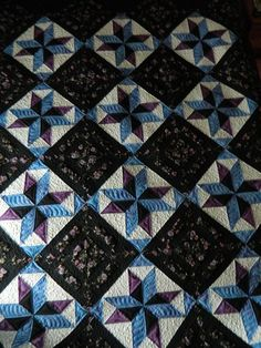 Black Beauty Quilt - love the black with some touches of gray and a light pastel with some white