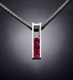 Ruby Necklace - Argentium Silver - 3503 - Argentium Chain Included Make a statement with this modern artisan crafted pendant. Cast in high purity Argentium 960, 100% recycled silver, this pendant measures 22mm x 6mm (7/8 x 1/4) and is channel set with three beautiful 4mm Chatham Rubies. ( IMPORTANT - PLEASE READ 1. AND 2 BELOW ) 1.) INCLUDED IN THE PRICE IS AN ARGENTIUM SILVER CHAIN APPROPRIATE FOR THE PENDANT CHOSEN. YOU CAN CHOOSE FROM 16, 18 OR 20 LENGTH AT CHECKOUT. 2.) PLEA...
