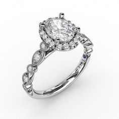 ($1430) Fana vintage halo engagement ring - Polish and shine take the lead on this unique engagement ring style. The diamonds weigh 0.40 carat total weight. #vintage #engagementrings #oval #diamond #milgrain