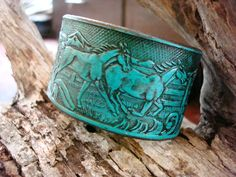 Turquoise+Embossed+Leather+cuff+featuring+horses+by+dirtynameranch,+$24.00
