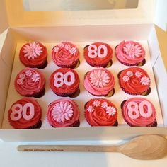 80th birthday cupcakes with fondant flowers by www.BuBakes.co.uk For more creations, tips and competitions like us at Facebook.com/bubakes