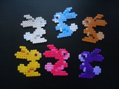 Colorful bunnies perler beads by anyeshouse on deviantart Melty Bead Patterns, Hama Beads Patterns, Beading Patterns, Hama Beads Animals, Perler Bead Templates, Peler Beads, Melting Beads, Beaded Ornaments, Fuse Beads