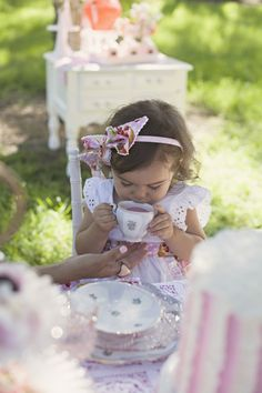 This little sweetie is adorable - tea drinking is an art that should be taught from a young age :)