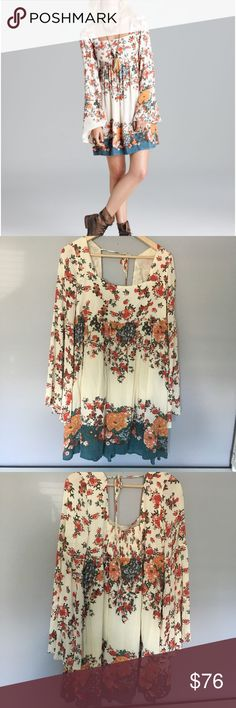 Free people dress Very cute free people flower bell sleeve dress. It's too big on me, but it's absolutely gorgeous and fun. Size L. Very good condition. Free People Dresses Long Sleeve