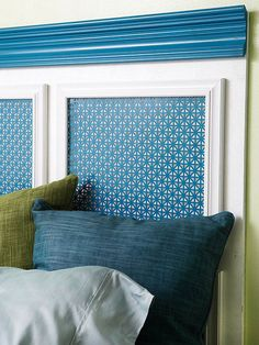 DIY Headboard | Picture frames, decorative molding, metal sheeting, and paint collaborate with the humble material to create a stunning focal point.