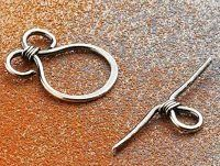 "Not a how-to, but pictures of 6 easy clasps from ""Handcrafted Wire Findings"" by Denise Peck and Jane Dickerson.  Looks like a useful book."