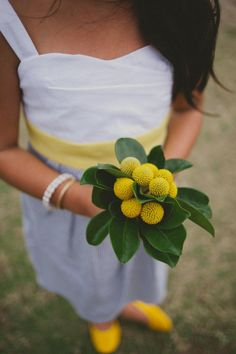 love this sweet flower girl bouquet of billy buttons