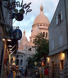 """""""One of our favorite things to do in Paris is wander the back alleys around Sacre-Coeur basilica during sunset and imagine that we are walking in the footsteps of van Gogh, who resided in the neighborhood."""""""