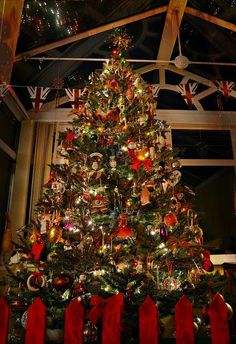 Classic Reds, greens, and golds adorn the Christmas tree in Congleton, England English Christmas, Merry Christmas To All, Noel Christmas, Christmas Is Coming, All Things Christmas, Christmas Lights, Christmas Tree Decorations, Holiday Decor, Xmas Tree