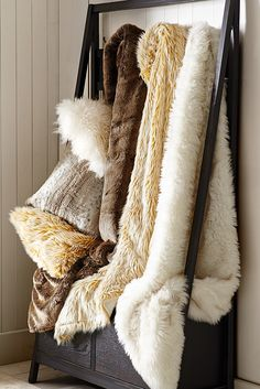 Christmastime is the best time for cuddling under a warm throw. Make your house feel like a Christmas lodge with a visit to the Pier 1 Fur Shop for faux fur throws, fuzzy pillows, cowhide rugs and more.