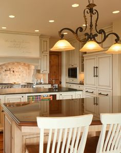 Kitchen, Two Islands, French Country, Wood Floors: Avgerakis Collaborate + Design + Build: Joe Karman Architecture