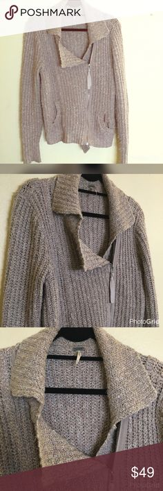 NWOT Free People sweater size medium Never worn extremely comfortable and soft Free People size medium zip up sweater. Slouchy look. Free People Sweaters