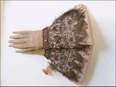 early pair of embroidered gloves with long extended fingers, circa 1595 - 1605