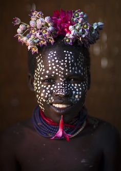 Kid With Flowers Decorations, Korcho, Omo Valley, Ethiopia by Eric Lafforgue Eric Lafforgue, Cultures Du Monde, World Cultures, We Are The World, People Of The World, Ethiopian People, Tribal Face, Arte Tribal, African Tribes
