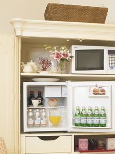 I managed to incorporate 'taste' into our bedroom by converting one of our armories into a mini-breakfast bar. It has everything we need for a quick breakfast-in-bed - a small refrigerator, a microwave and, of course, coffee & tea to get us going!