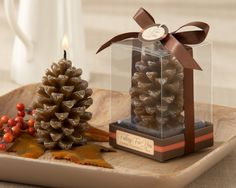 """""""Falling for You"""" Scented Pine Cone Candle (Set of 4)  http://favorcouture.theaspenshops.com/images/Product/20122NA_Pinecone_Candle_M.jpg"""