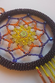 Shop for dreamcatcher on Etsy, the place to express your creativity through the buying and selling of handmade and vintage goods. Baubles And Beads, Beaded Ornaments, Beautiful Dream Catchers, Beaded Jewelry, Beaded Bracelets, Indian Beadwork, Crystal Beads, Crystals, Bead Art