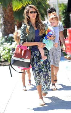 How to Wear a Printed Maxi Skirt with an Army Jacket Like Jessica Alba